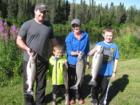 Turner Family showing off their fish.