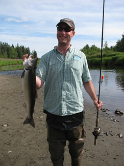 Dave finds it hard not to smile when he keeps catching salmon.