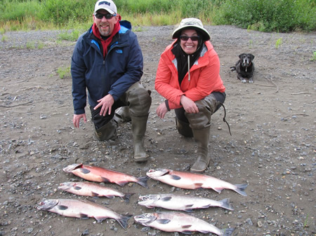 Alan and Karen with a great catch of Silvers as Ally watches for bears